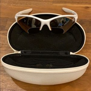 Lightweight white rimless Oakleys